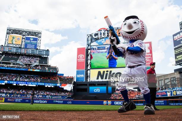 New York Mets mascot Mr Met shoots tshirts into the stands during the game between the New York Mets and the Milwaukee Brewers at Citi Field on...