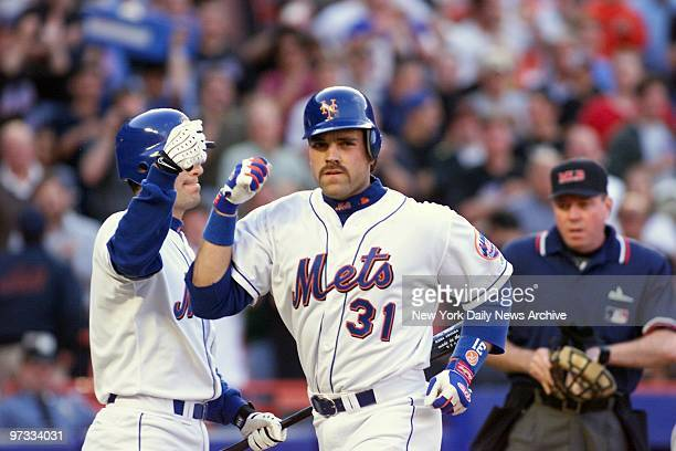 New York Mets' Mike Piazza gets congratulated by teammate Robin Ventura after hitting a solo homer in the first inning against the Baltimore Orioles...