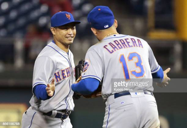 New York Mets' Norichika Aoki celebrates with teammate Asdrubal Cabrera in Philadelphia on Sept 30 after a 74 victory over the Philadelphia Phillies...