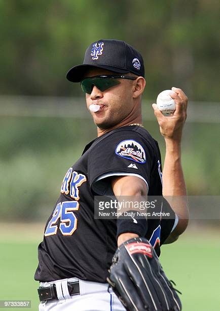 New York Mets' outfielder Alex Escobar warms up at a spring training practice session in Port St Lucie Fla