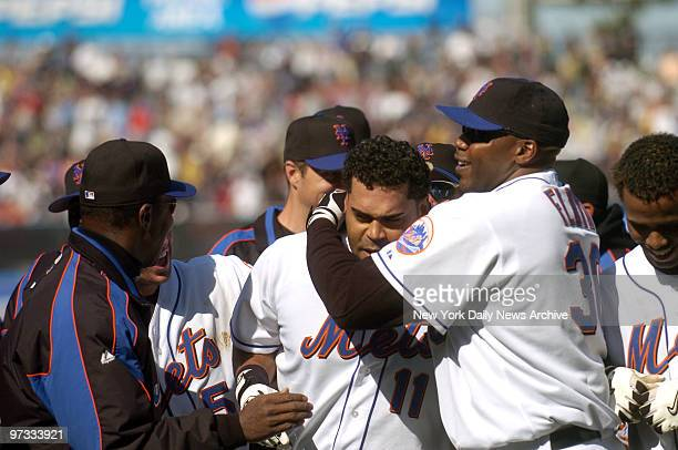 New York Mets' outfielder Cliff Floyd jubilantly congratulates catcher Ramon Castro on his gamewinning single during the ninth inning of game against...