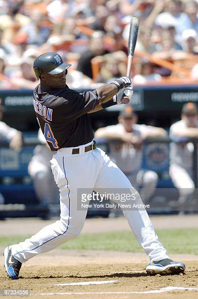 New York Mets' outfielder Mike Cameron hits a solo home run to right field in the first inning of game against the San Francisco Giants at Shea...