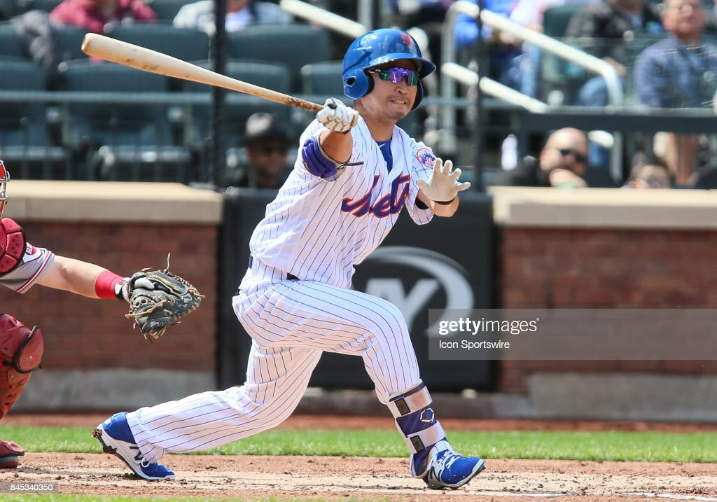 New York Mets Outfielder Norichika Aoki (11) doubles during the first inning of the Major League Baseball game between the Cincinnati Reds and the New York Mets on September 10, 2017 at Citi Field in Flushing, NY.