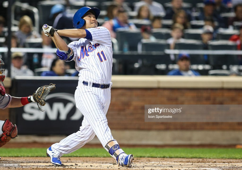New York Mets Outfielder Norichika Aoki (11) in action during the Major League Baseball game between the Cincinnati Reds and the New York Mets on September 9, 2017 at Citi Field in Flushing, NY.
