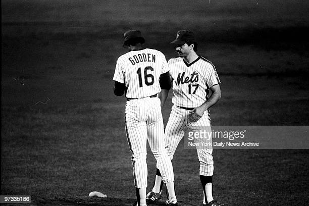New York Mets' pitcher Dwight Gooden and first baseman Keith Hernandez have a meeting on the mound during Game Two of the 1986 World Series. Boston...