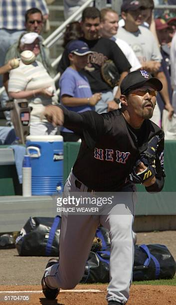 New York Mets pitcher Japanese Satoru Komiyama fires a ball 10 March 2002 during warmups for a game against the Saint Louis Cardinals in Jupiter...