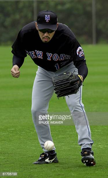 New York Mets pitcher Japanese Satoru Komiyama goes after a hopping ball 16 February 2002 during the Mets first day of spring training in Port St...