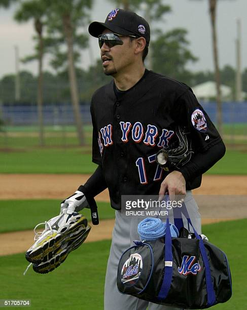 New York Mets pitcher Japanese Satoru Komiyama heads for a practice field with his gear16 February 2002 during the Mets first day of spring training...