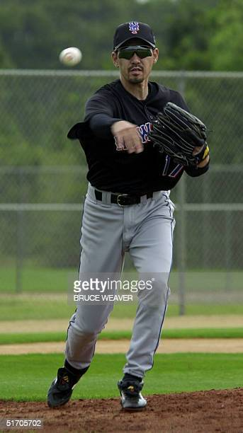New York Mets pitcher Japanese Satoru Komiyama makes a throw to first base 16 February 2002 during the Mets first day of spring training in Port St...