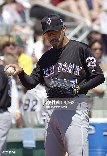 New York Mets pitcher Japanese Satoru Komiyama signals his catcher 10 March 2002 during warmups for a game against the Saint Louis Cardinals in...