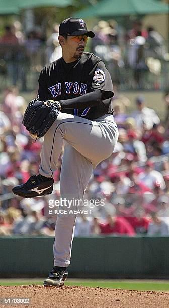 New York Mets pitcher Japanese Satoru Komiyama winds up 10 March 2002 during a game against the Saint Louis Cardinals in Jupiter Florida Komiyama...