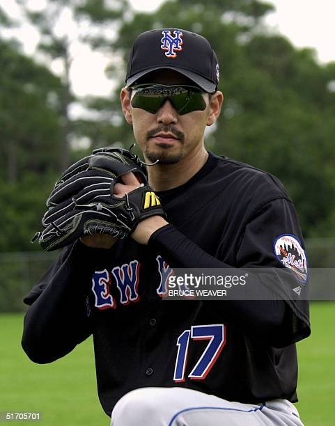 New York Mets pitcher Japanese Satoru Komiyama winds up for a pitch 16 February 2002 during the Mets first day of spring training in Port St Lucie FL...