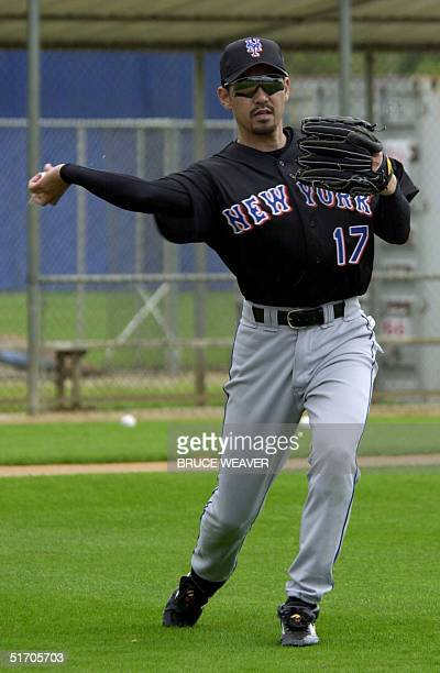 New York Mets pitcher Japanese Satoru Komiyama winds up to throw 16 February 2002 during the Mets first day of spring training in Port St Lucie FL...