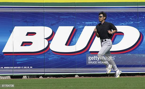 New York Mets pitcher Japanese Satoru Komiyama works on conditioning 10 March 2002 after pitching in a game against the Saint Louis Cardinals in...
