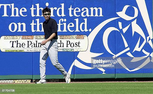 New York Mets pitcher Japanese Satoru Komiyama works on his conditioning 10 March 2002 after pitching in a game against the Saint Louis Cardinals in...
