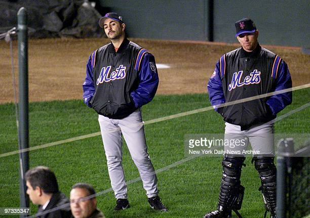 New York Mets' pitcher John Franco and catcher Vance Wilson are downcast in the bullpen during the ninth inning of Game 2 of the World Series as...