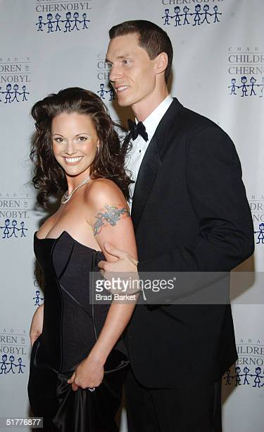 New York Mets Pitcher Kris Benson and Anna Benson arrive at the Children At Heart Gala To Benefit Children Of Chernobyl on November 22 2004 at Pier...