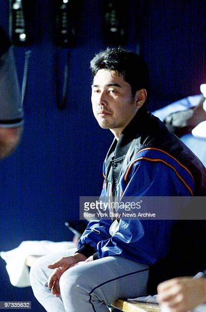 New York Mets' pitcher Masato Yoshii sits in the dugout during Game 1 of the NLCS against the Atlanta Braves in AtlantaThe Braves won 42 Yoshii left...