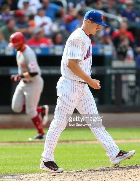 New York Mets Pitcher Paul Sewald reacts after surrendering a home run to Cincinnati Reds Shortstop Zack Cozart during the seventh inning of the...