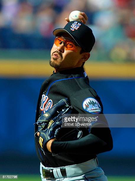 New York Mets pitcher Saturo Komiyama throws to the plate during their baseball game with the Atlanta Braves at Turner Field in Atlanta 07 April 2002...