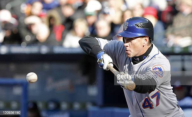 New York Mets pitcher Tom Glavine lays down a sacrifice bunt during the game between the Atlanta Braves and the New York Mets at Turner Field in...