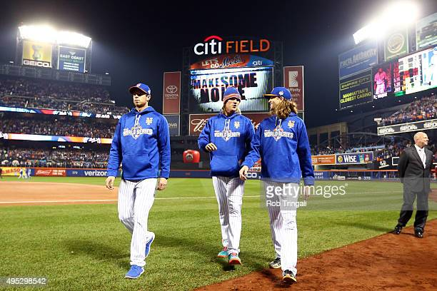 New York Mets pitchers Steven Matz Noah Syndergaard and Jacob deGrom 48 walk back to the dugout prior to Game 5 of the 2015 World Series against the...