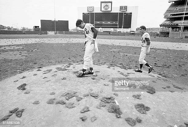 Mets' pitchers Tom Seaver and Gary Gentry who both won 1969 World Series games against the Orioles survey the mound and what once was their playing...
