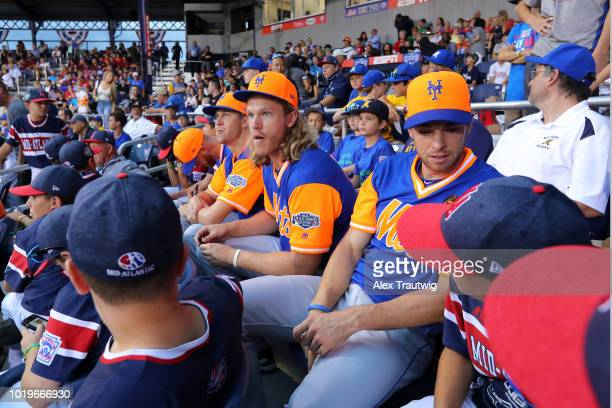 New York Mets pitchers Zack Wheeler Jacob deGrom Noah Syndergaard and Steven Matz sit in the stands and watch the game with the MidAtlantic team from...
