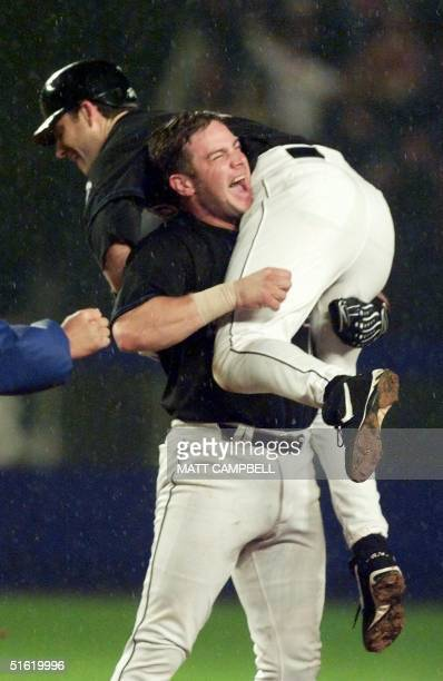 New York Mets player Robin Ventura is lifted in the arms of teammate Todd Pratt after Ventura's hit cleared the fence to beat the Atlanta Braves 43...
