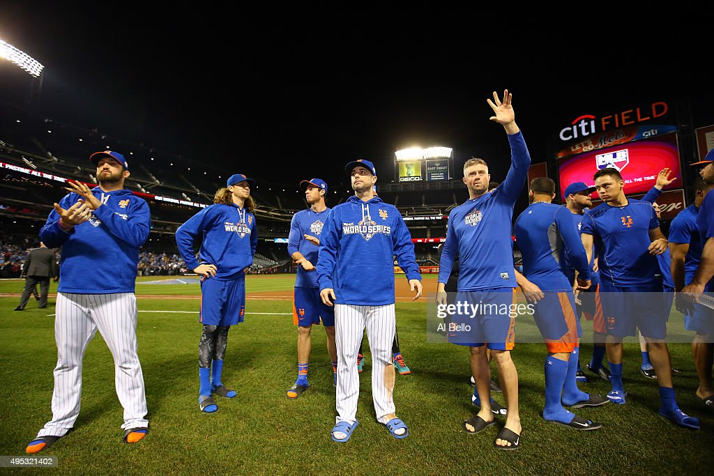 New York Mets players Jonathon Niese #49, Jacob deGrom #48, and David Wright #5 wave to fans after Game Five of the 2015 World Series at Citi Field on November 1, 2015 in the Flushing neighborhood of the Queens borough of New York City. The Kansas City Royals defeated the New York Mets with a score of 7 to 2 to win the World Series.