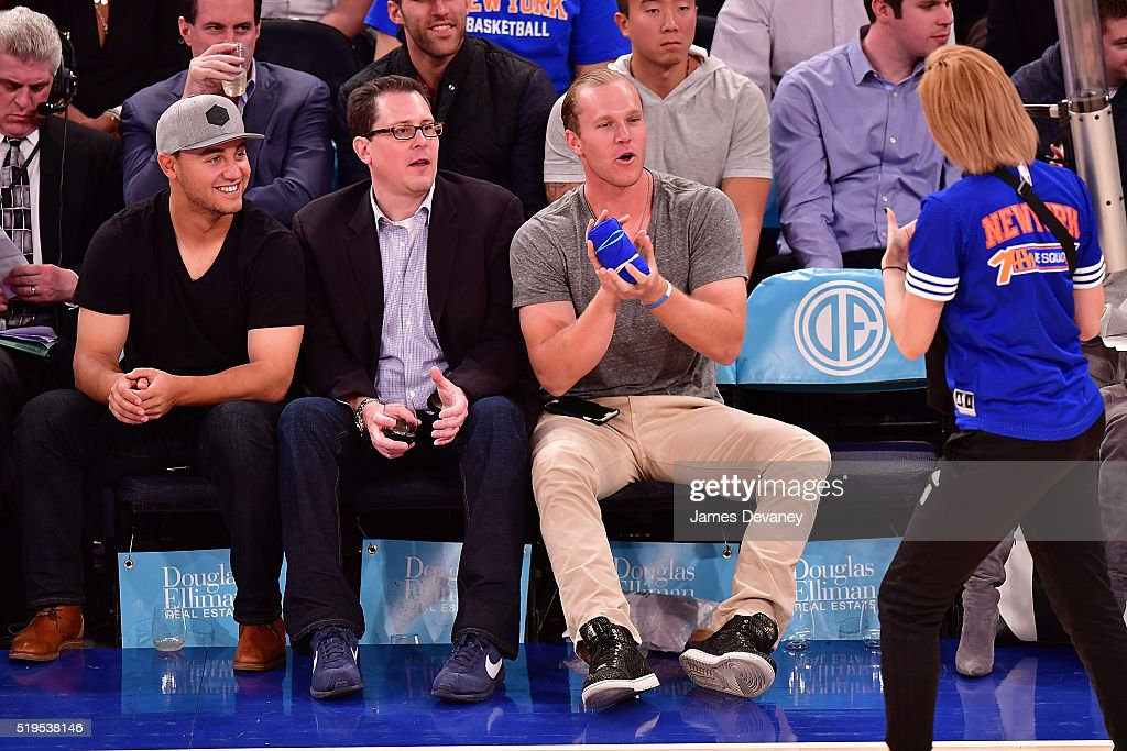 New York Mets players Michael Conforto (L) and Noah Syndergaard (R) attend the Charlotte Bobcats vs New York Knicks game at Madison Square Garden on April 6, 2016 in New York City.