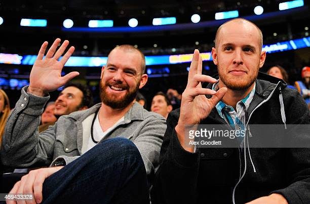 New York Mets players Vic Black and Zack Wheeler look on during a game between the New York Knicks and Philadelphia 76ers at Madison Square Garden on...