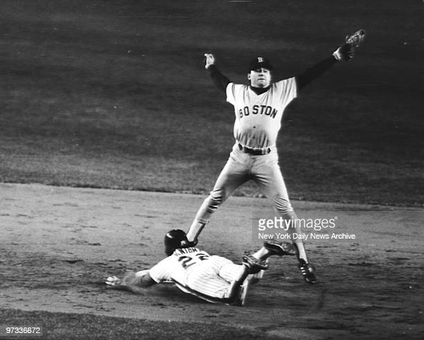 New York Mets' Ray Knight is safe at 2nd base on a play after a base hit bunt by Mookie Wilson, as Boston Red Sox shortstop Spike Owen takes throw...