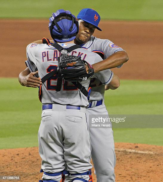 New York Mets relief pitcher Jeurys Familia celebrates the team's victory over the Miami Marlins with catcher Kevin Plawecki during the ninth inning...