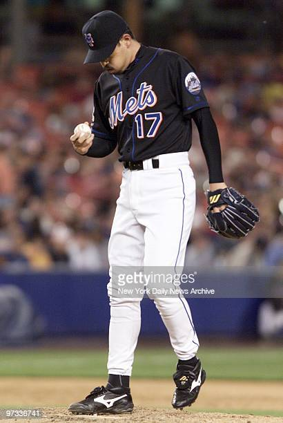 New York Mets relief pitcher Satoru Komiyama ponders his previous pitch after giving up a solo homer in the ninth inning against the Minnesota Twins...