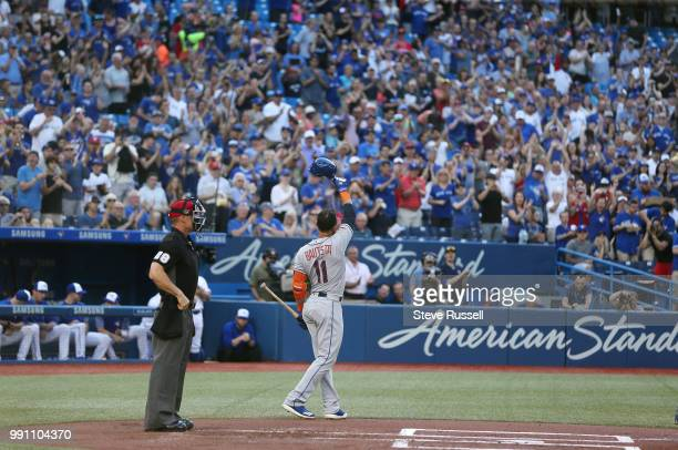 TORONTO ON JULY 3 New York Mets right fielder Jose Bautista acknowledges the fans before his first at bat in Toronto since leaving the Toronto Blue...