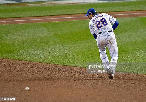 New York Mets second baseman Daniel Murphy misplays a ground ball hit by the Kansas City Royals' Eric Hosmer in the eighth inning allowing Ben...