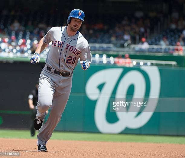 New York Mets second baseman Daniel Murphy rounds the bases after hitting a home run off Washington Nationals starting pitcher Jordan Zimmermann...