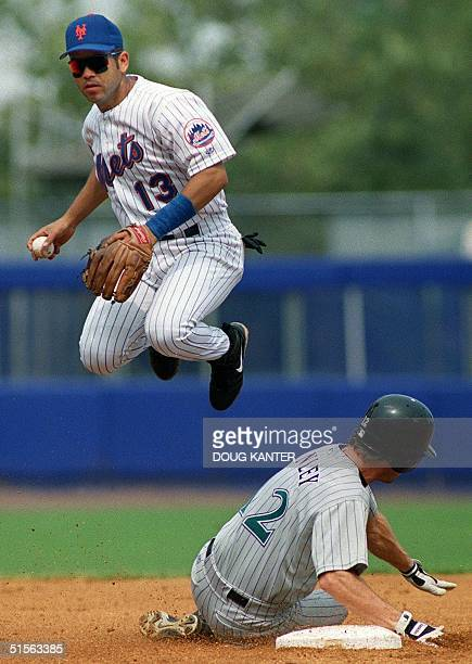 New York Mets second baseman Edgardo Alfonzo jumps over Arizona Diamondbacks Steve Finley after getting the out at second base during the second...