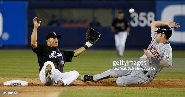 New York Mets' second baseman Jose Valentin slips and falls as Minnesota Twins' Justin Morneau steals second in the fifth inning of a game at Shea...