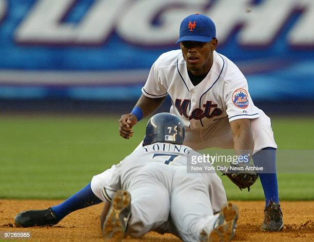 New York Mets' shortstop Jose Reyes puts the tag on Milwaulkee Brewers' Eric Young as he tries to steal second in the first inning The Brewers went...