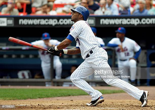 New York Mets' shortstop Jose Reyes smacks a threerun homer to right field to tie the game against the Philadelphia Phillies 33 in the second inning...