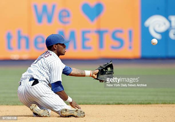 New York Mets' shortstop Jose Reyes tosses the ball with his glove to second baseman Miguel Cairo for an out in the eighth inning against the Los...