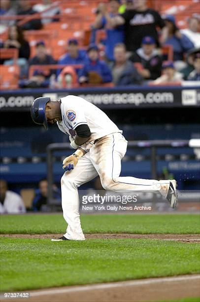 New York Mets' shortstop Jose Reyes winces in pain after he was hit with a pitch by San Francisco Giants' starter Matt Cain during the fifth inning...
