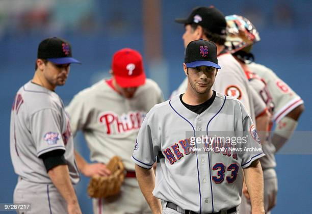 New York Mets' starter John Maine is unhappy as he walks off the mound as teammate David Wright looks on in the sixth inning of the fourth game...