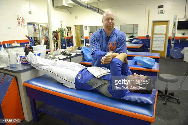New York Mets starting pitcher Matt Harvey stretching with trainer Dave Pearson.