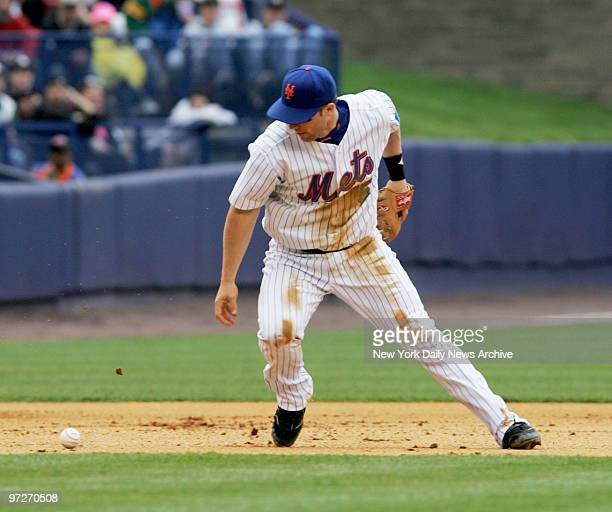 New York Mets' third baseman David Wright bobbles a ball in the eighth inning for an error that allowed the New York Yankees' Tony Womack to reach...