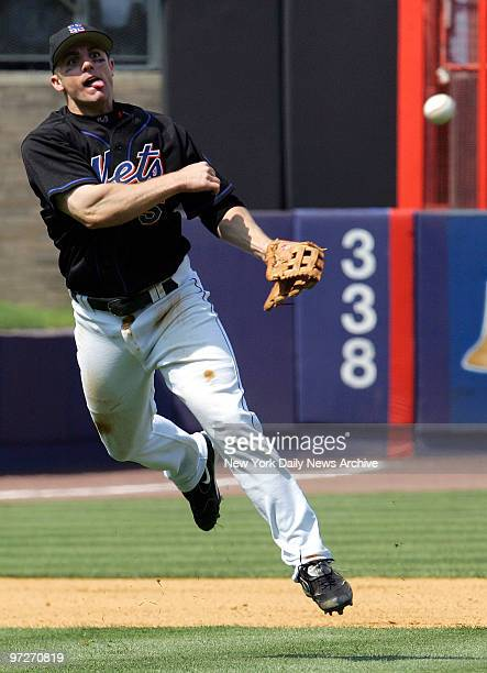 New York Mets' third baseman David Wright throws but can't get the St Louis Cardinals' Scott Seabol out at first during the seventh inning of game at...
