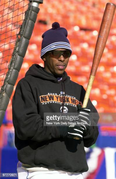 New York Mets' Timo Perez is ready for a cool World Series in practice session at Shea Stadium
