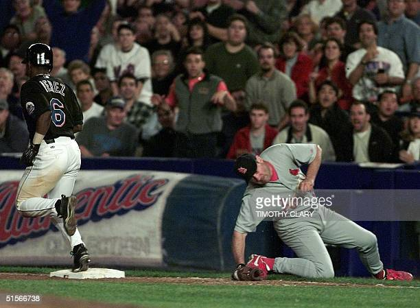 New York Mets' Timo Perez is safe at first as St. Louis Cardinals first baseman Will Clark tries to tag in the sixth inning during game four of the...